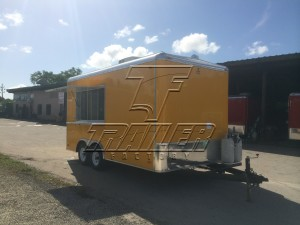 Yellow concession trailer with hitch.